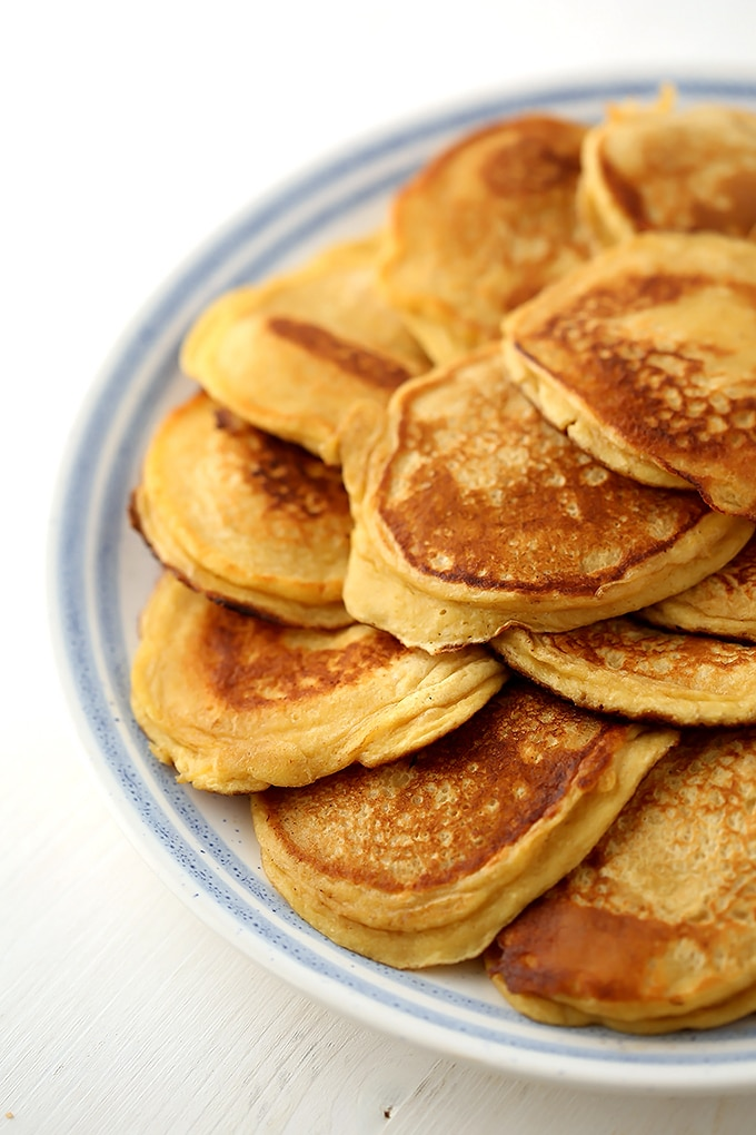 kefir pancakes laying on a large plate
