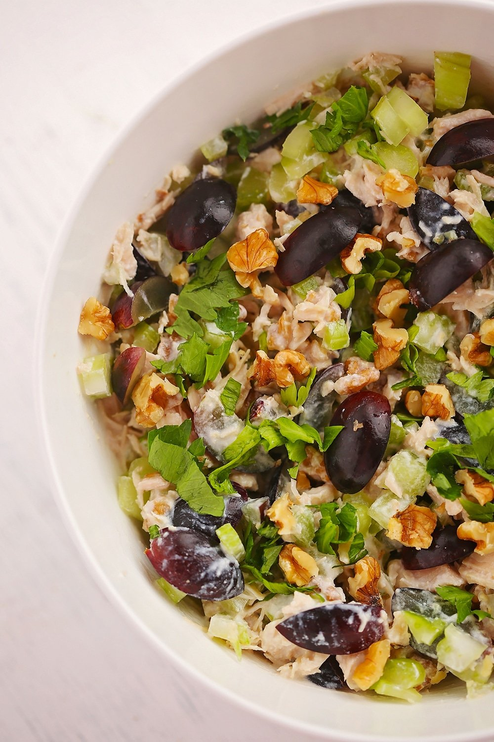 chicken salad with grapes served in a white bowl