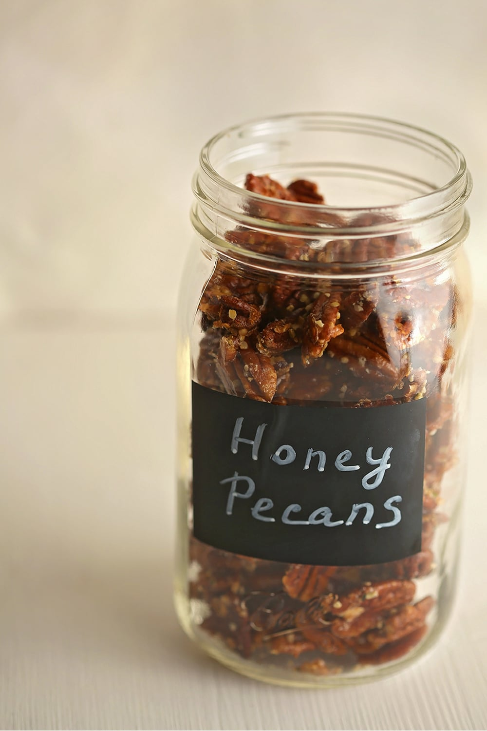 mason jar filled with roasted pecans