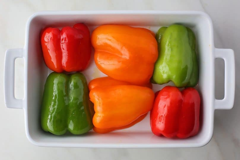 bell peppers in the baking dish before going inside the oven