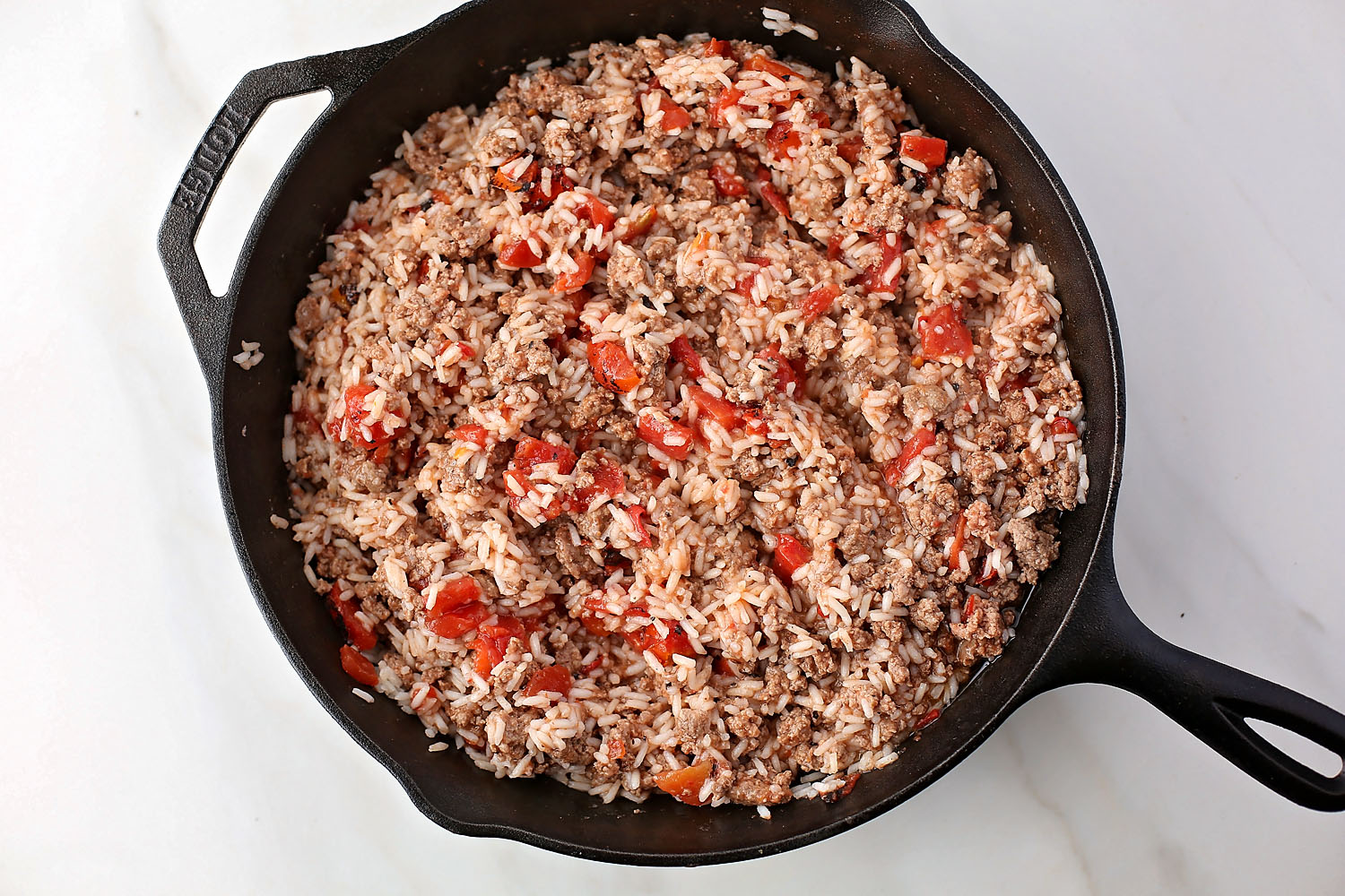 skillet with beef, tomatoes and rice