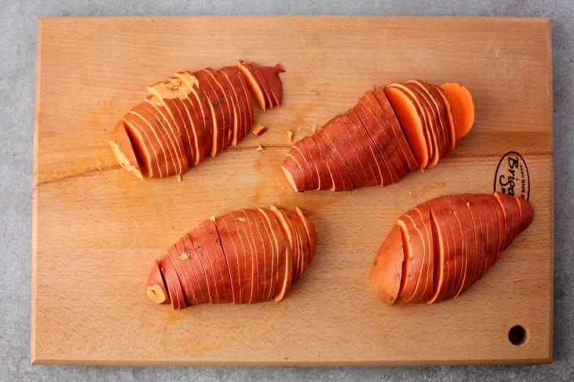 sweet potatoes sliced on the cutting board