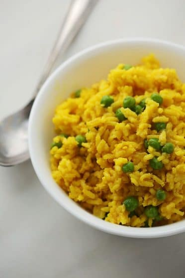 a bowl with Turmeric Chicken Rice