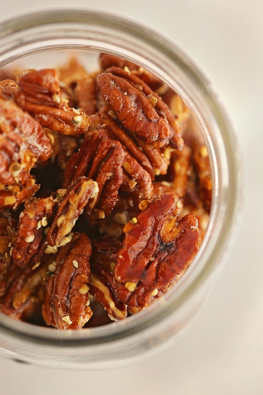 macro shot of roasted pecans