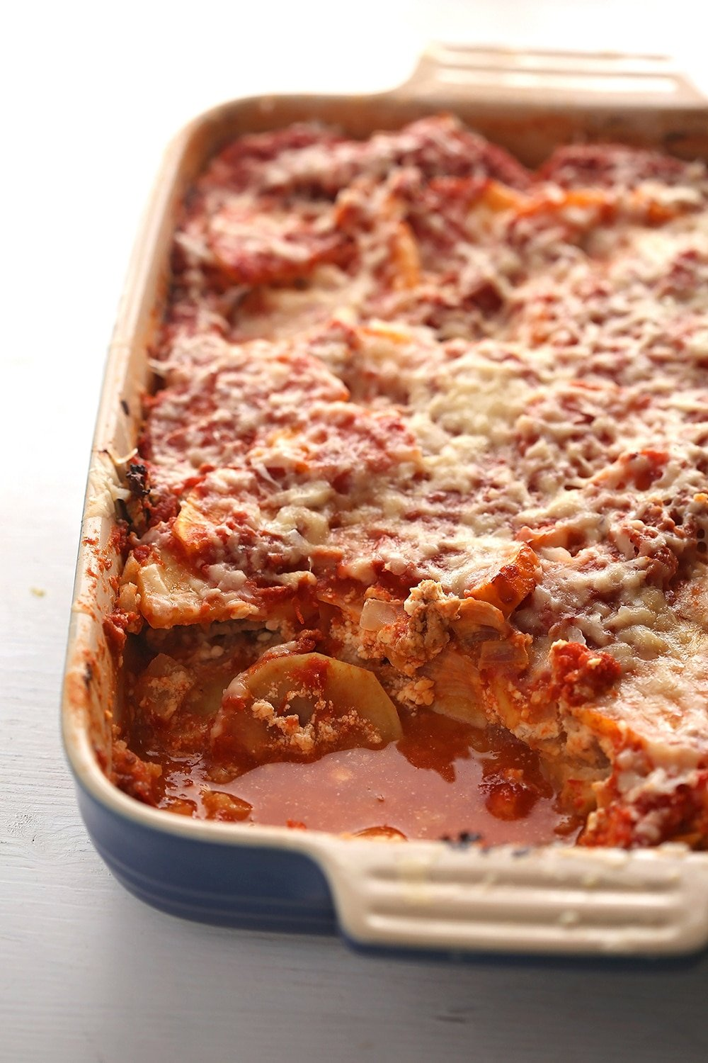 sweet potato lasagna in a baking dish missing one piece