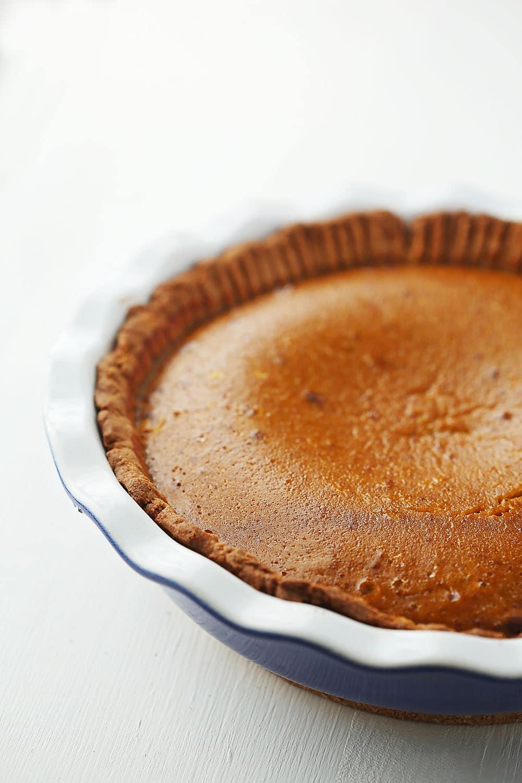 pie dish with whole pumpkin pie