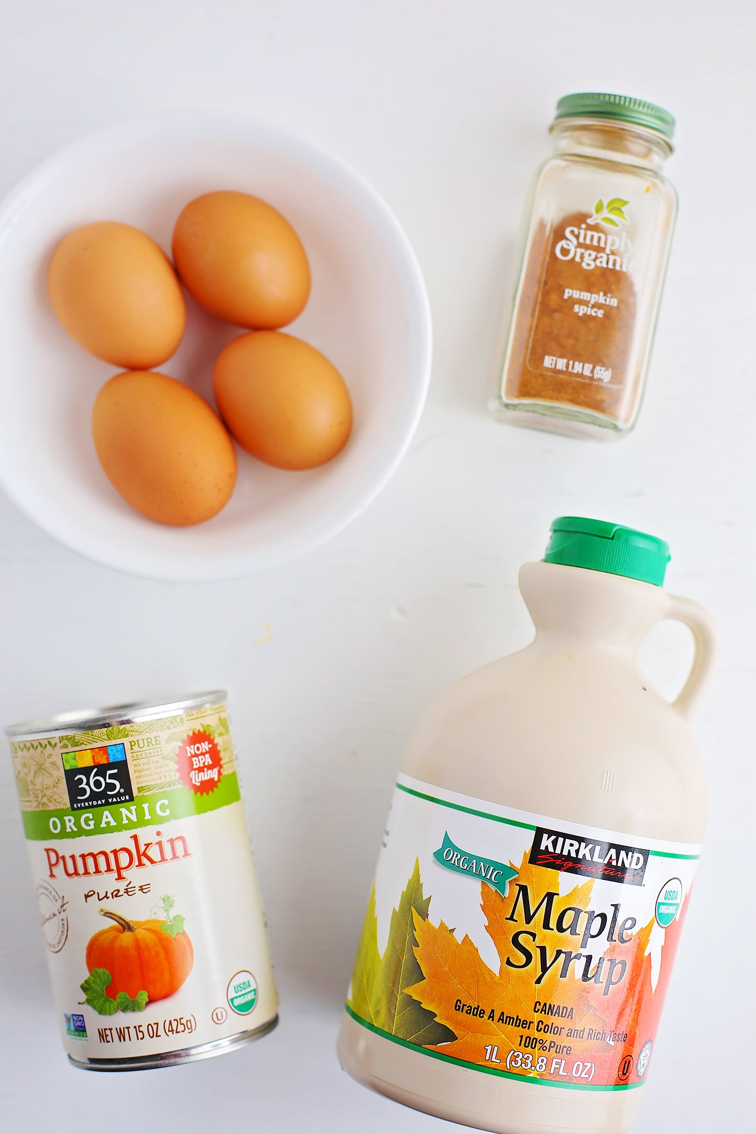 ingredients for making pumpkin pie on the white surface