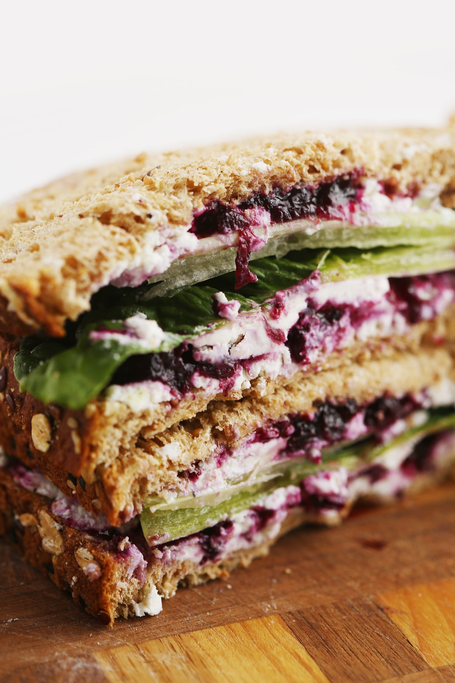 Goat Cheese Sandwich with Wild Blueberry Jam served on a wooden board