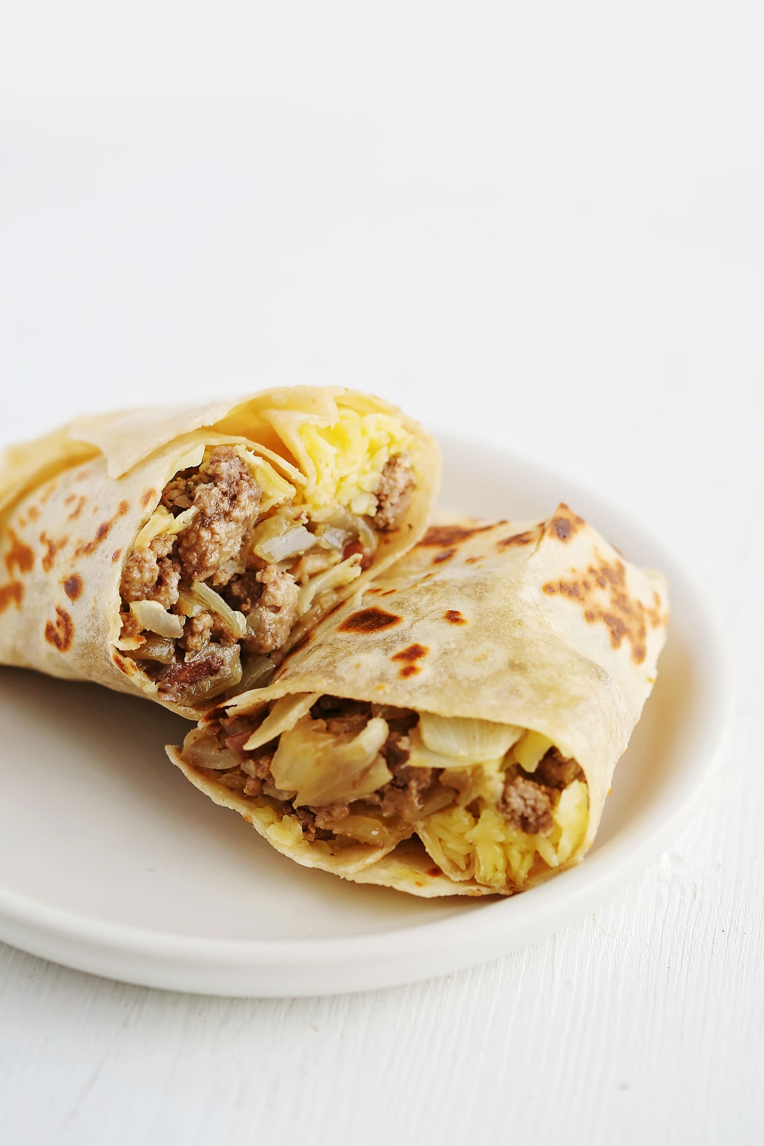 Stuffed Tortilla with Beef and Sweet Onions on the white plate
