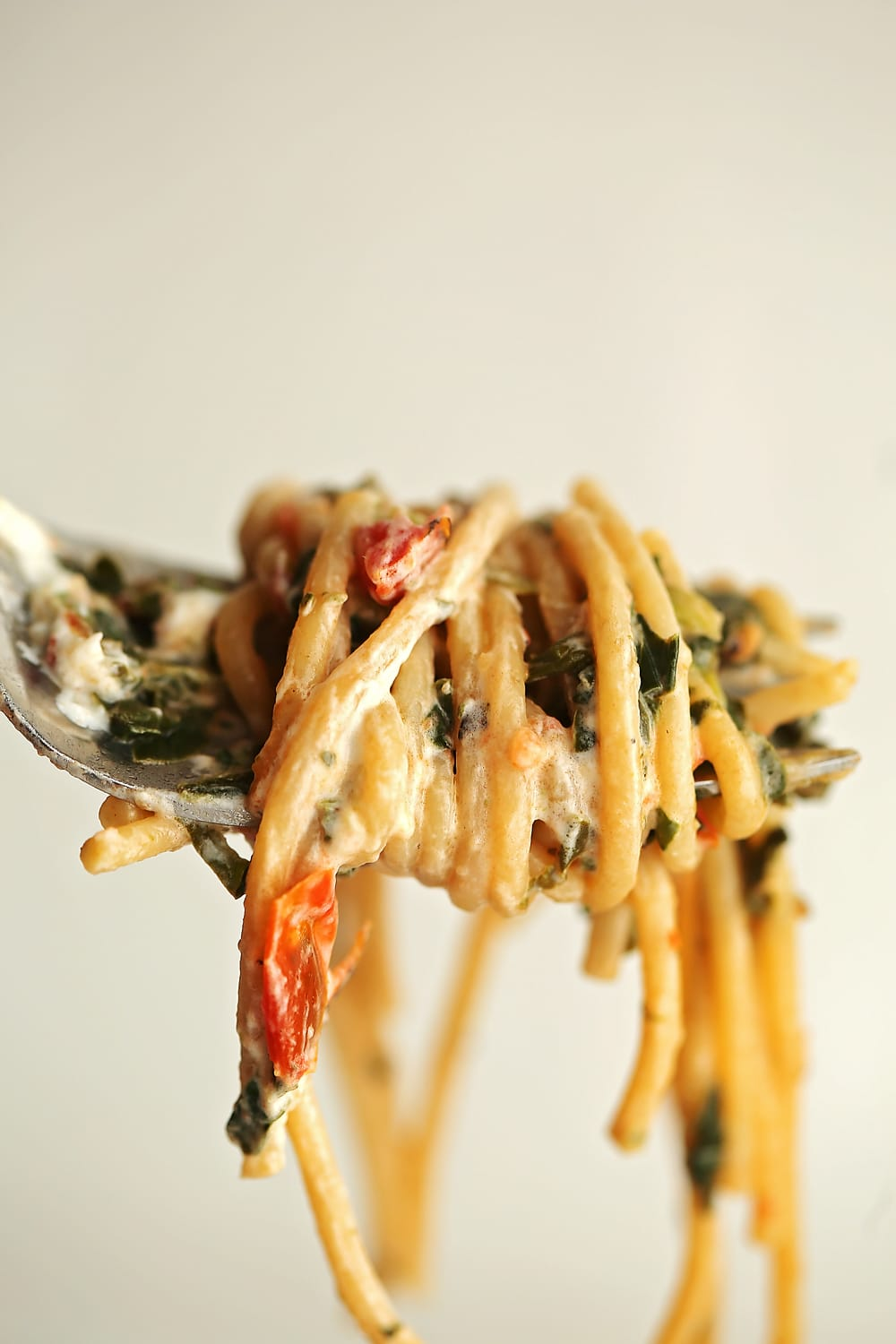 fork with Pasta with Goat Cheese and Spinach