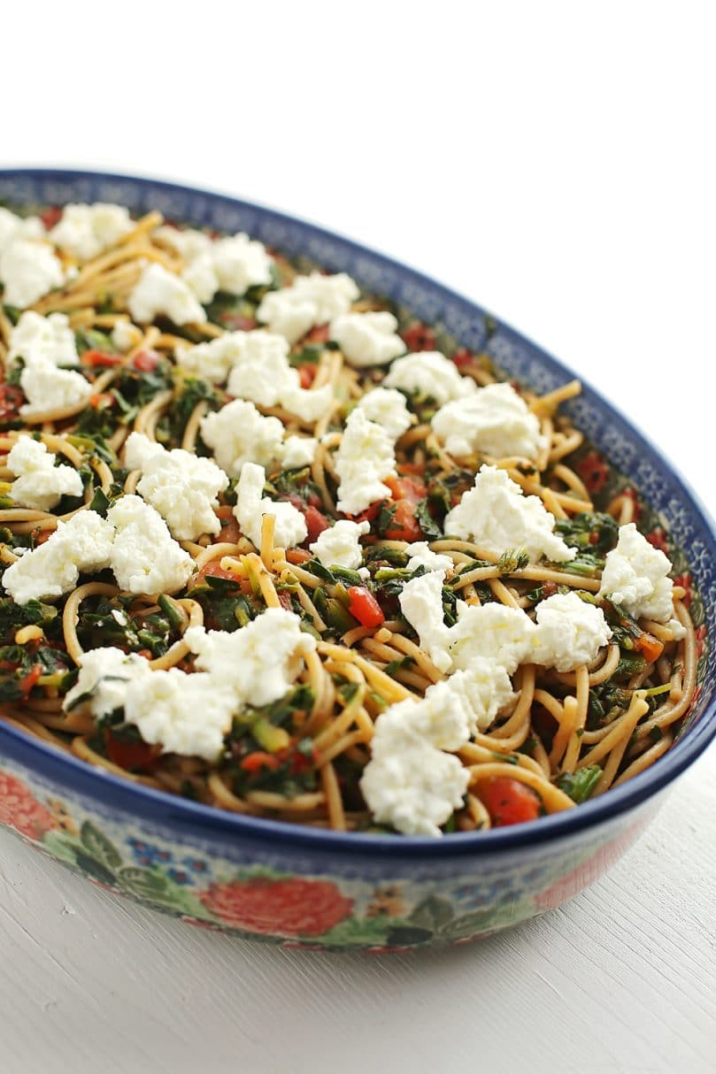 Pasta with Goat Cheese and Spinach served in a colorful bowl