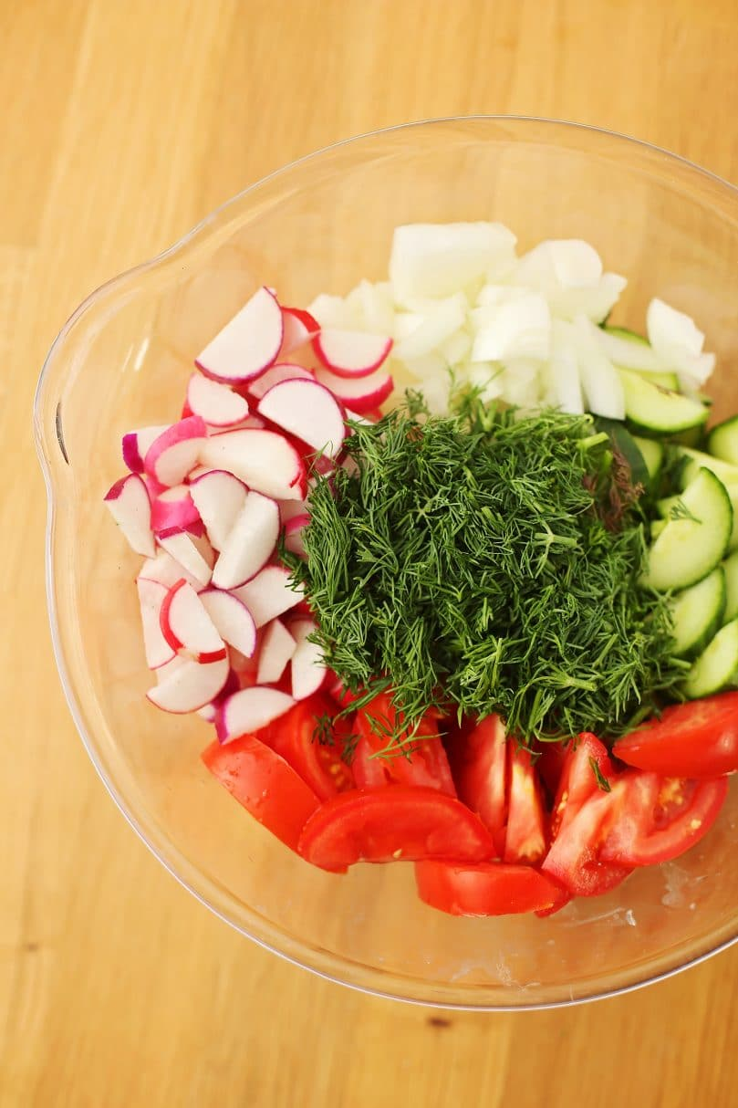 wooden tabletop with fresh diced vegetables