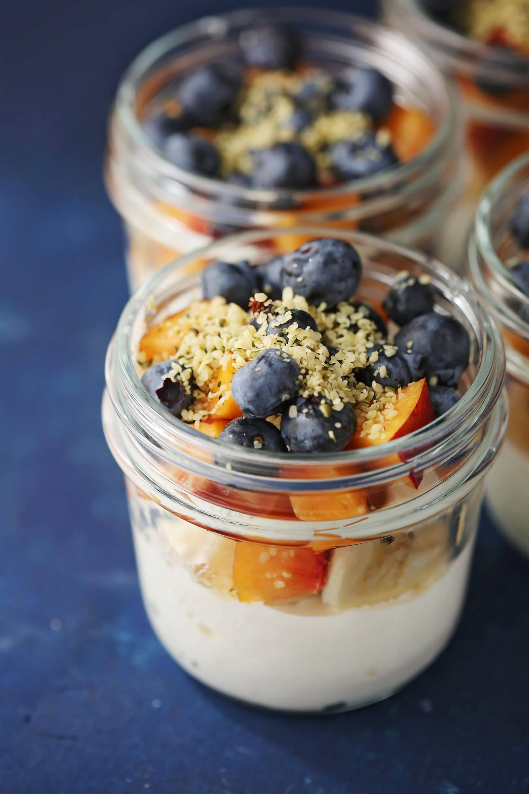 mason jars with cottage cheese, peaches and blueberries