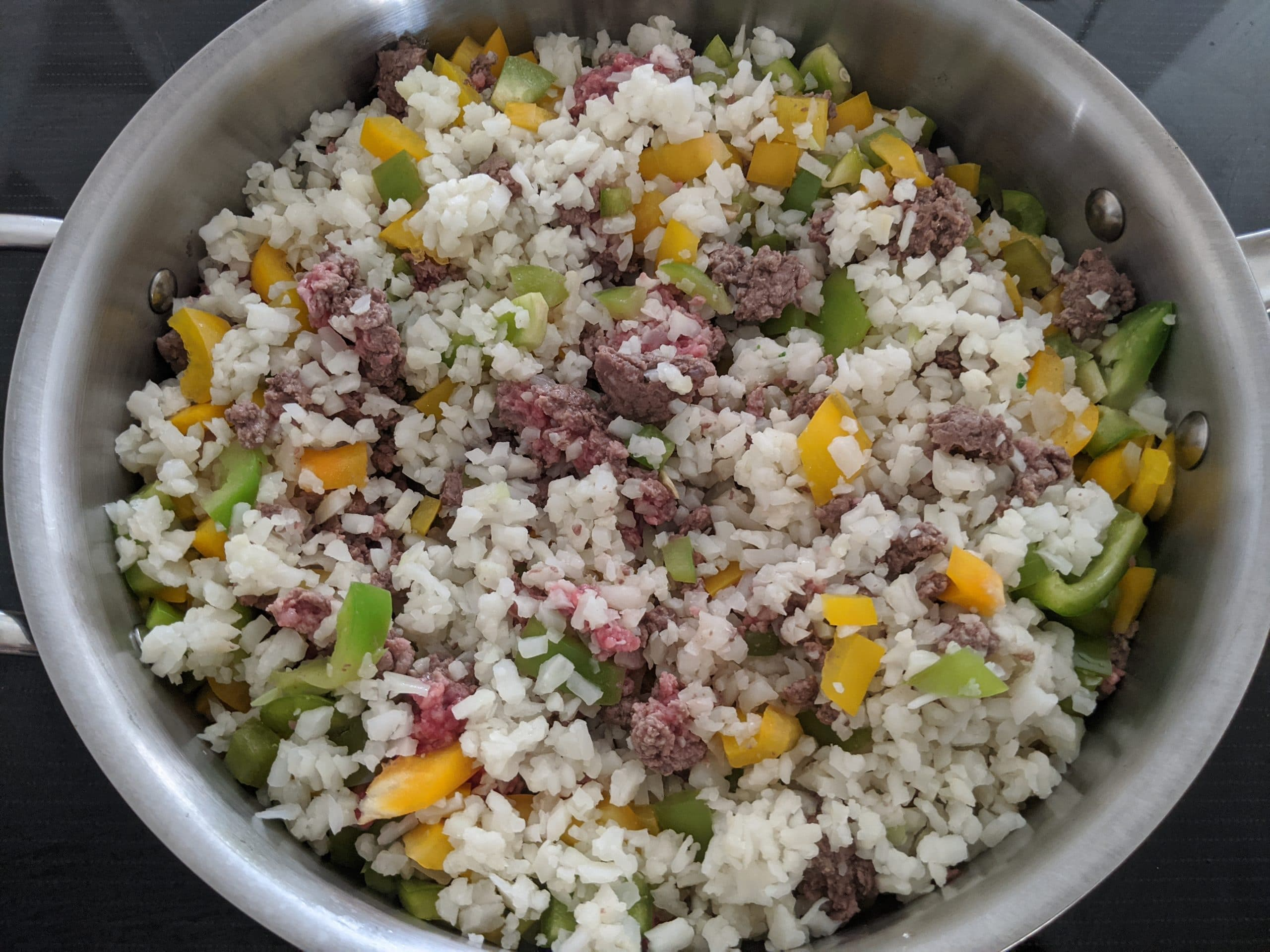 ground beef, peppers and rice cauliflower in the skillet