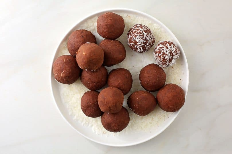 chocolate truffles balls in the plate with coconut flakes