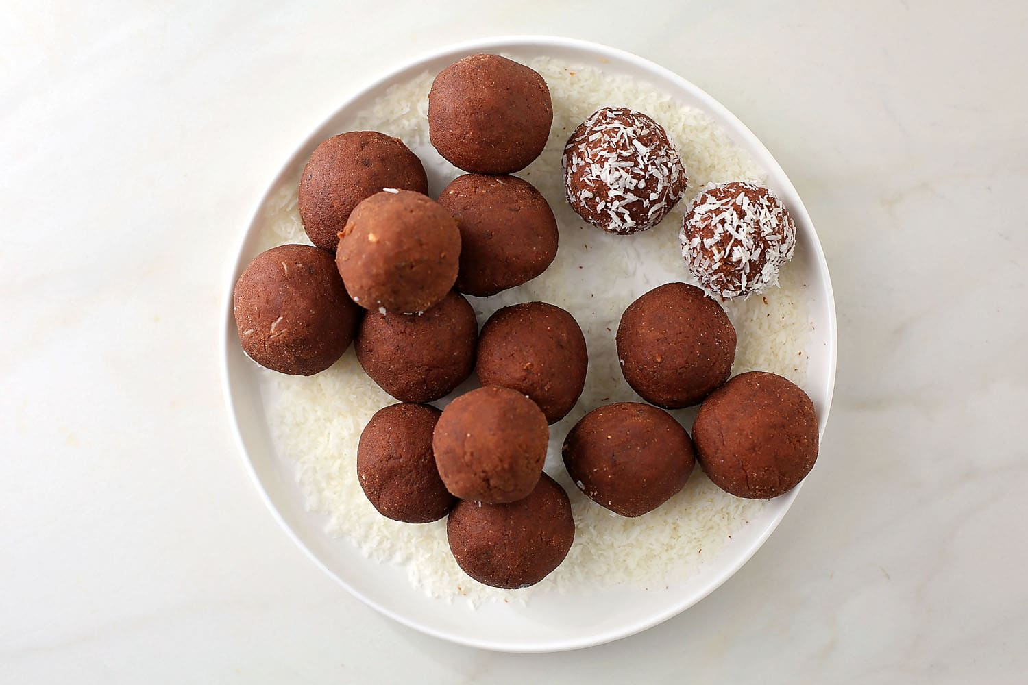 No-Bake Chocolate Truffles balls in the plate with coconut flakes