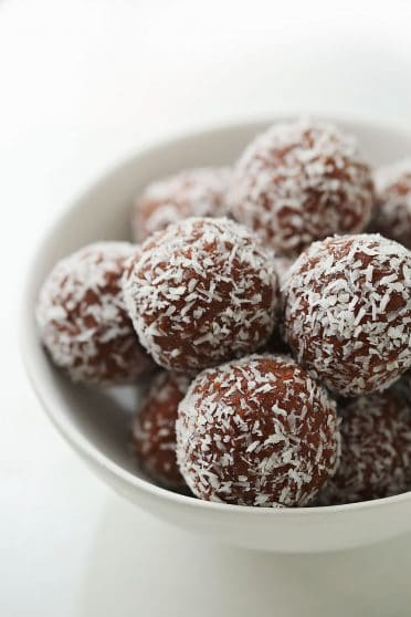 several no-bake chocolate truffles inside the white bowl