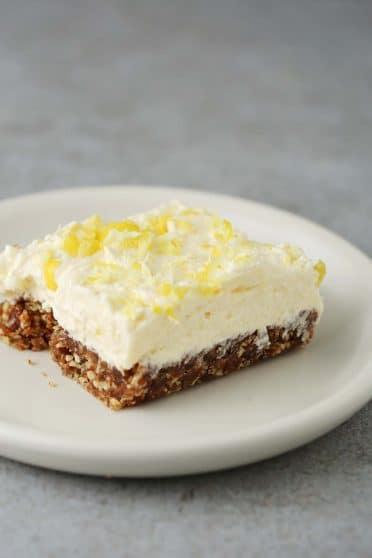 lemon cream pie on a serving white plate