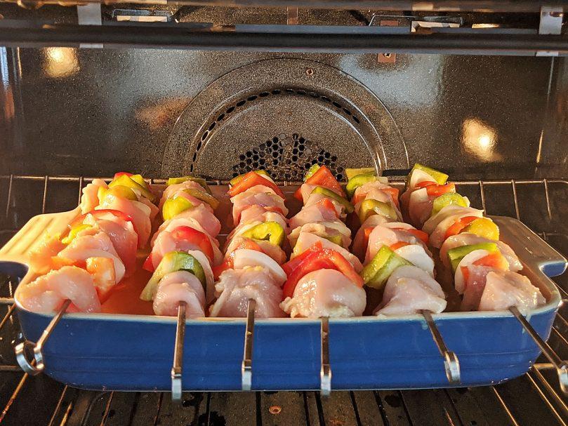 chicken skewers baking in the oven