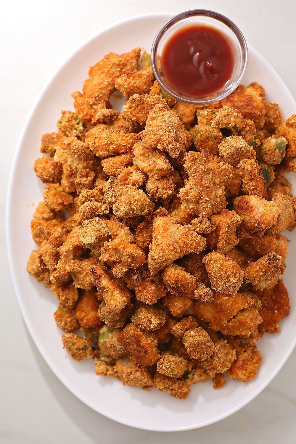 plate with fried okra and chicken