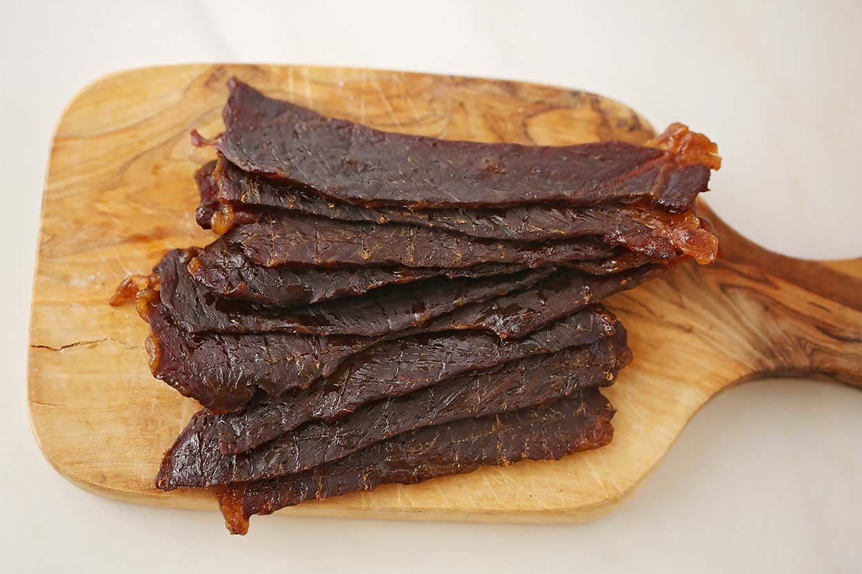 dried jerky strips on the cutting board