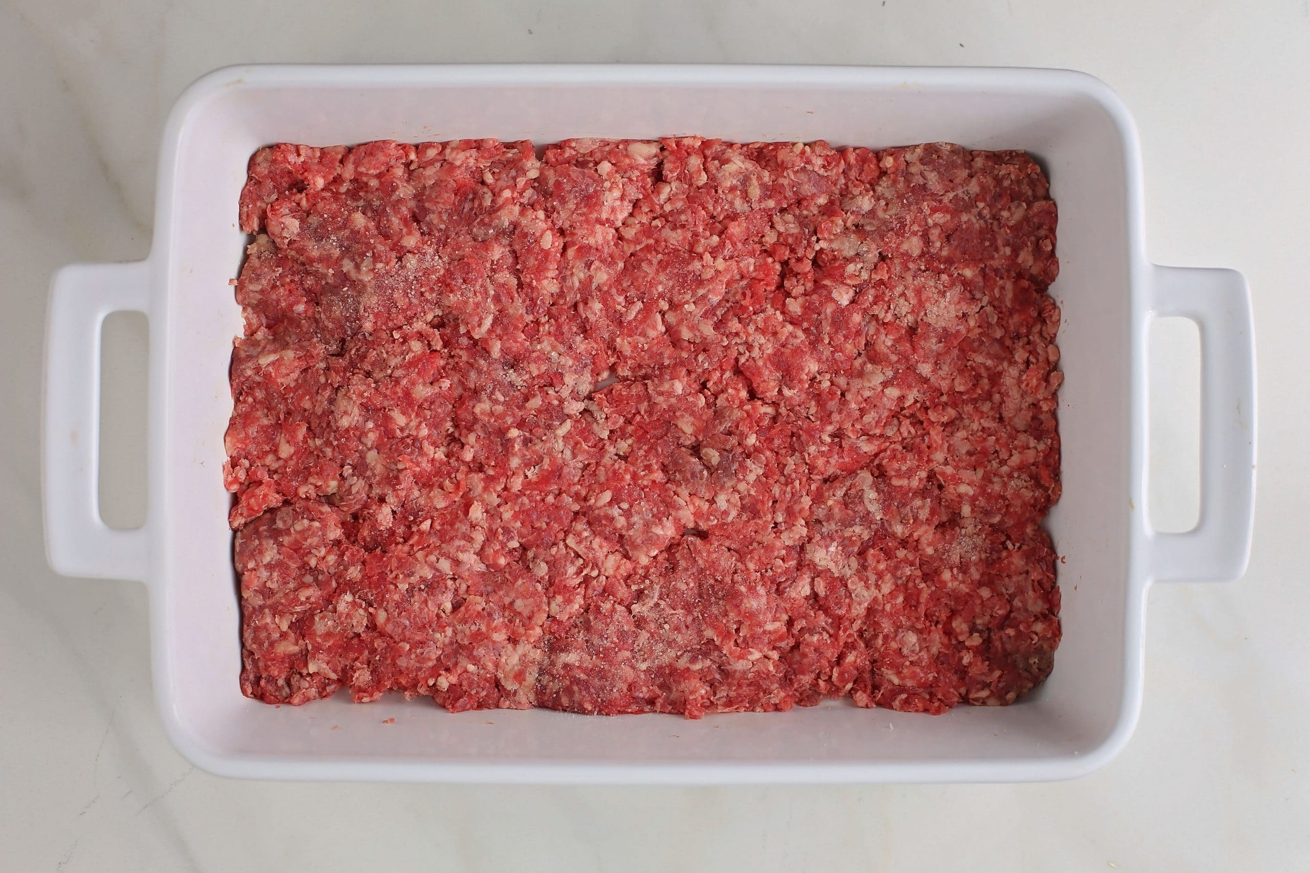 ground beef layer in the baking dish