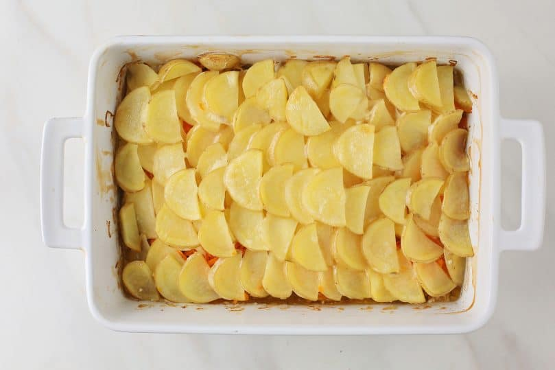 cooked layer of potatoes in the making of casserole