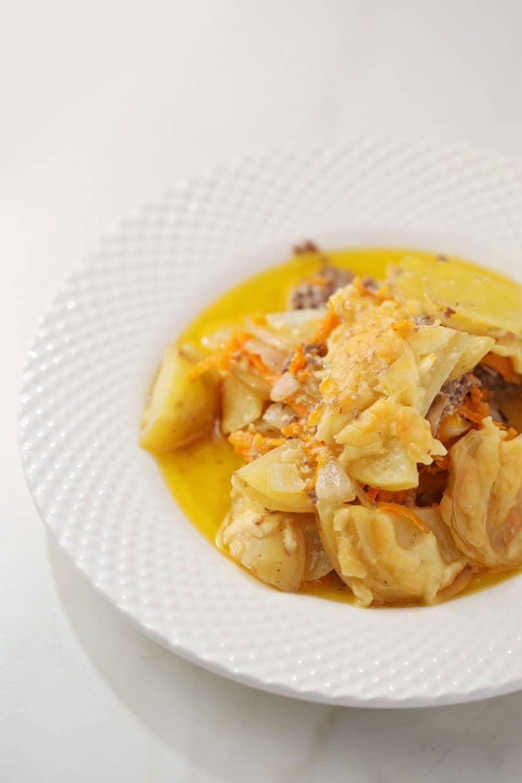 potato casserole served on a white dish