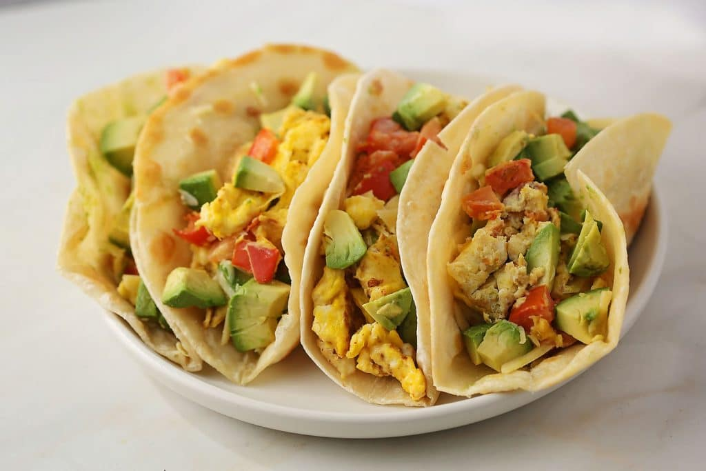 tacos with avocado on the plate