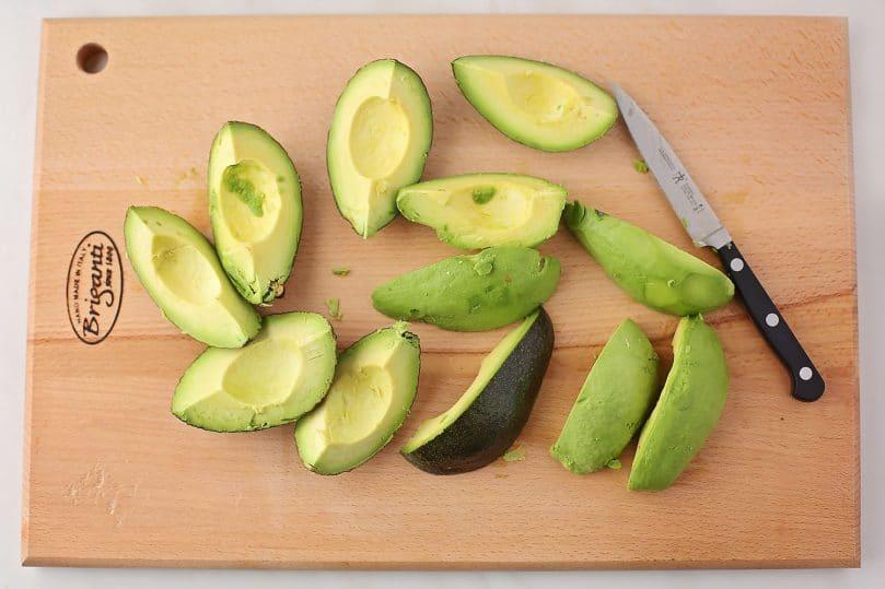 sliced avocado on a wooden board
