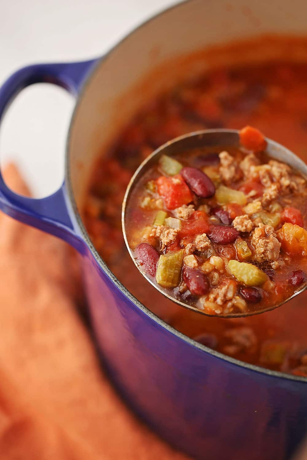 dutch oven pot with cooked Ground Beef Farro Stew