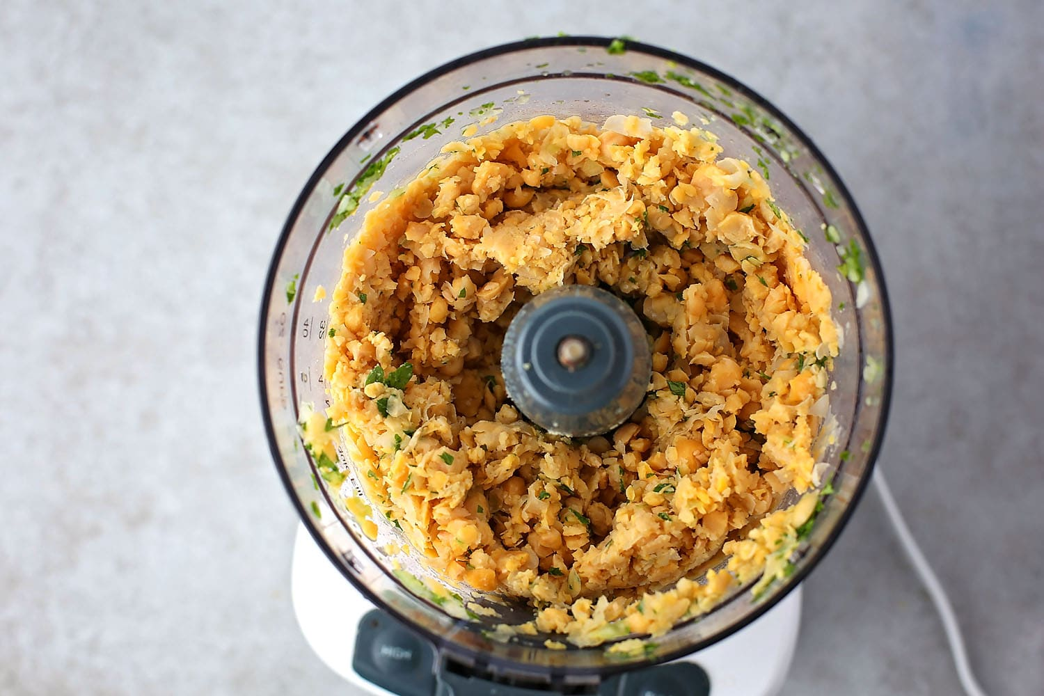 food processor with mixture to make falafel