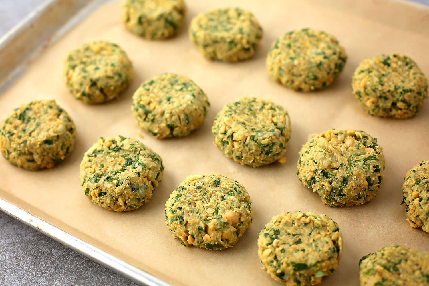 Falafel balls on the baking sheet before going in the oven