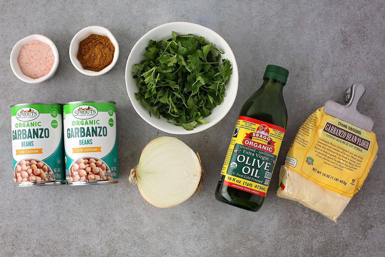 ingredients for Falafel, olive oil, chickpeas, cumin, salt, onion, cilantro, and bean flour