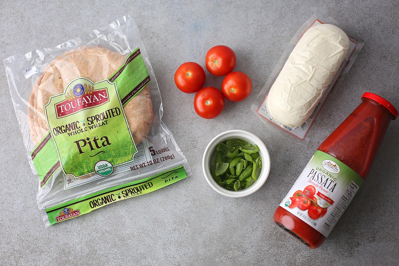 ingredients to make Quick & Easy Pita Pizza (10-minute pizza), pita, tomato, tomato sauce, basil, mozzarella cheese