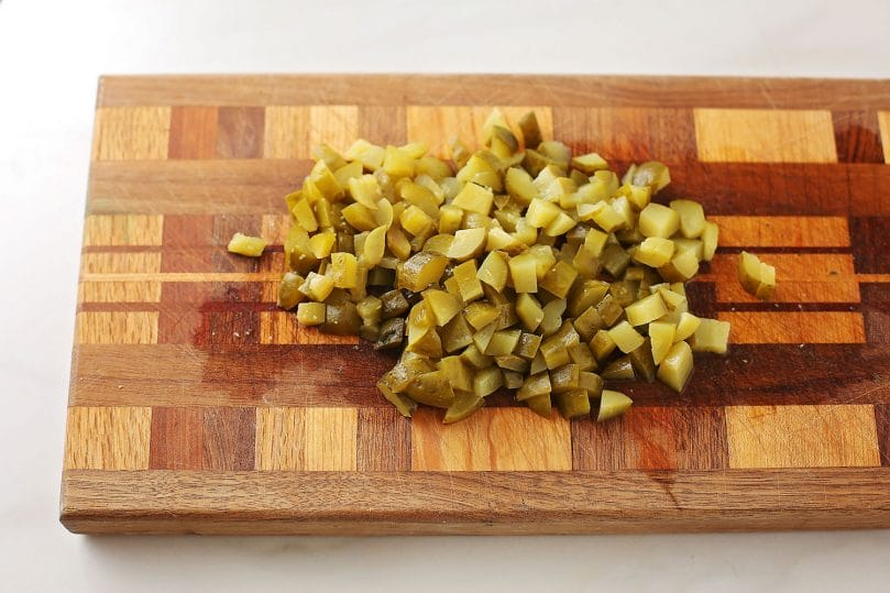 cutting board with the diced pickles