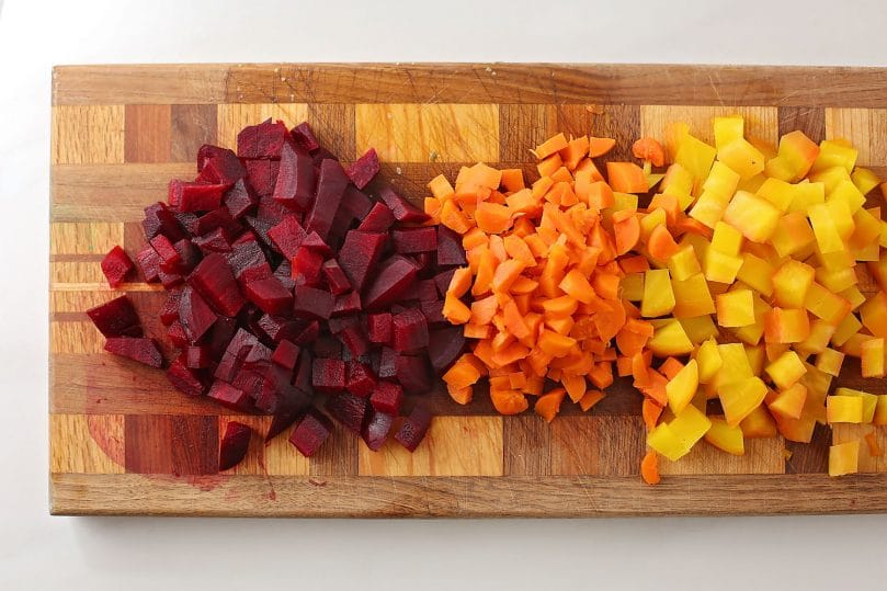 diced beets, carrots and potatoes on the cutting board
