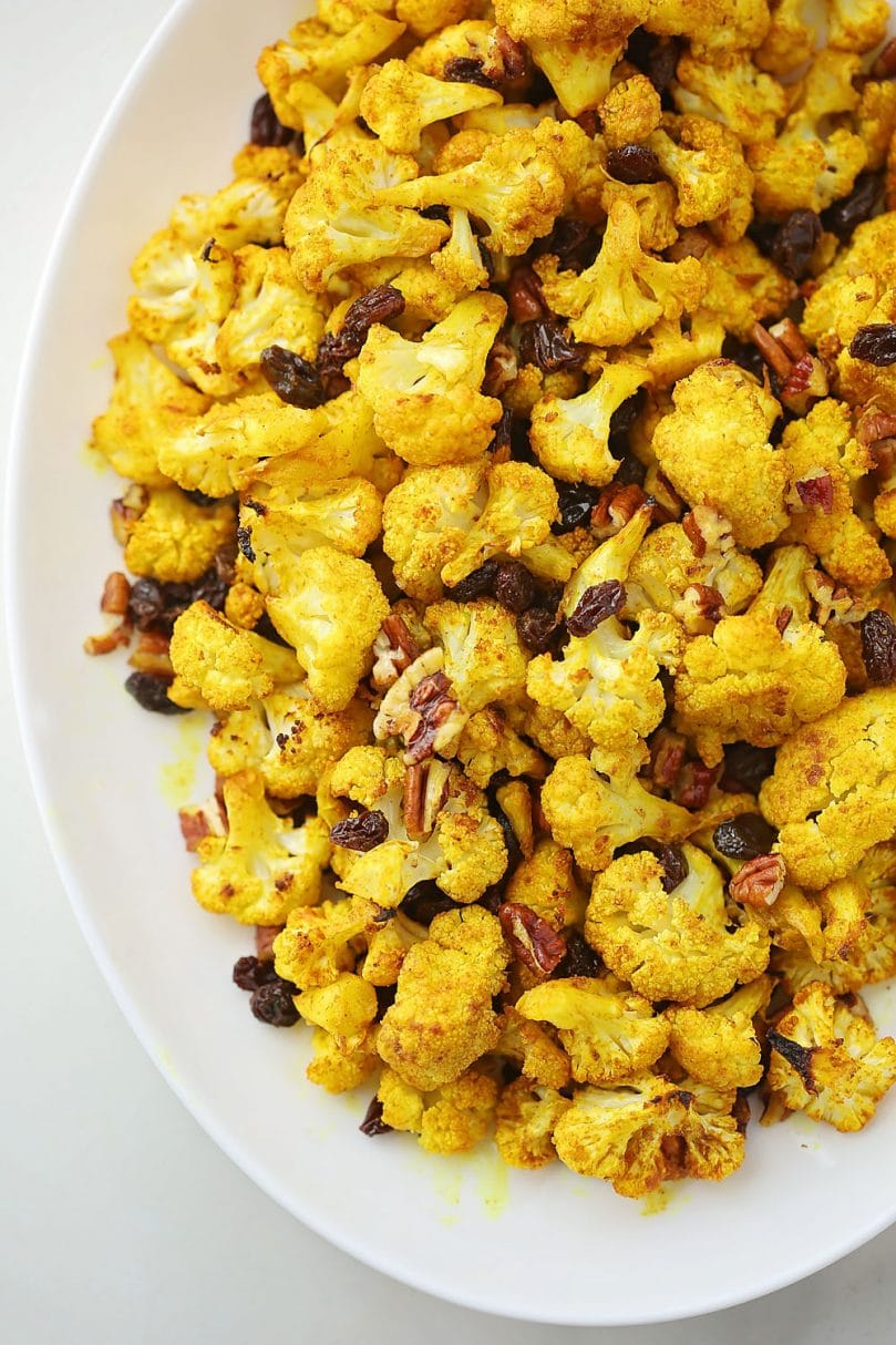 oval plate with curry roasted cauliflower with raisins