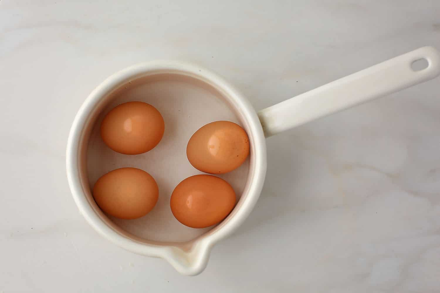 pan with boiled eggs