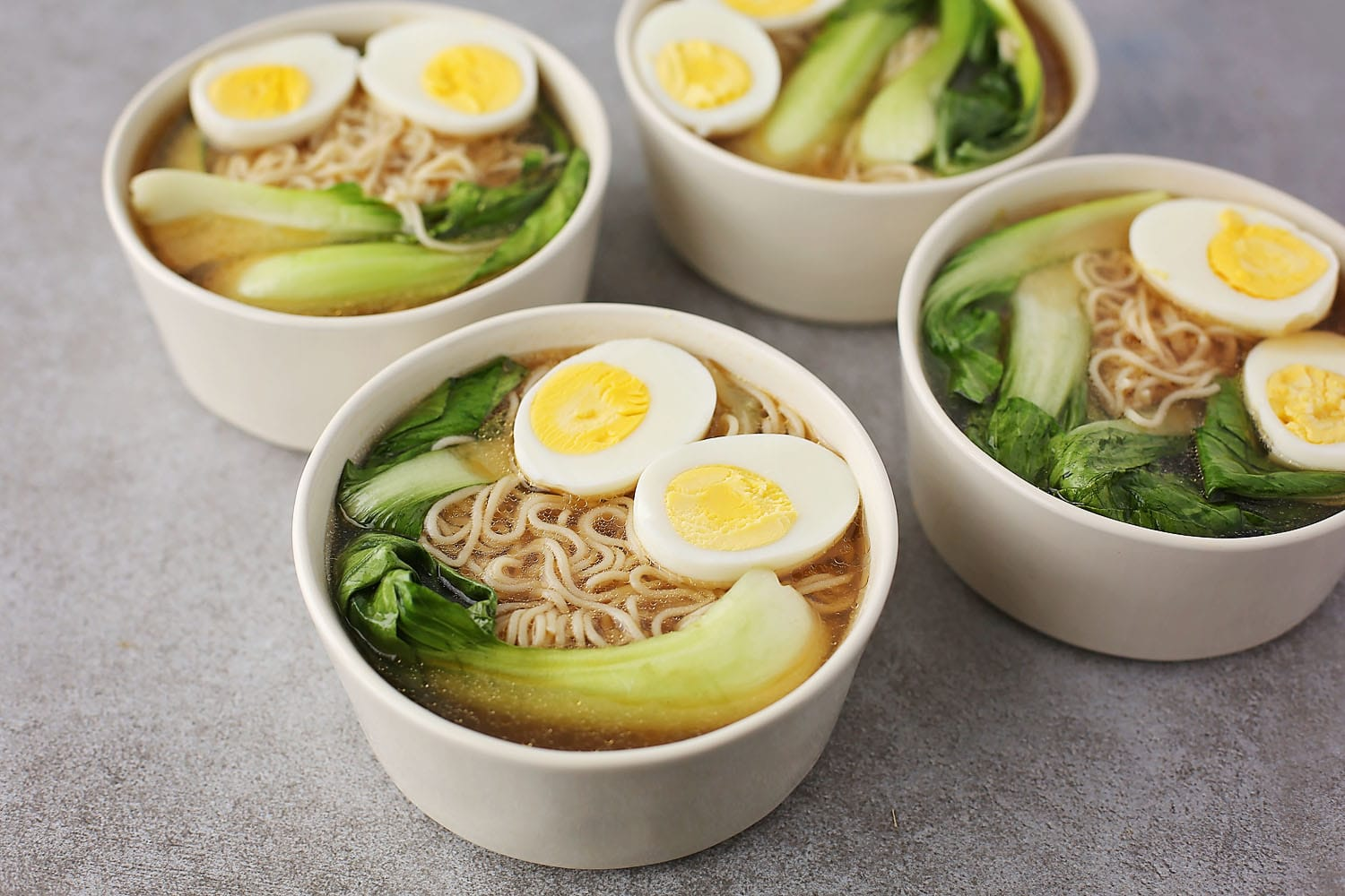 four bowls filled with Easy Ramen Broth Bowls
