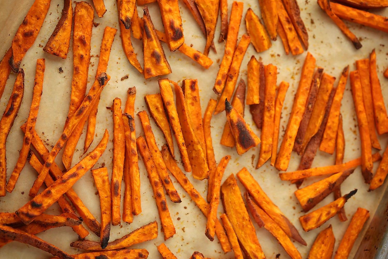 sheet pan with baked sweet potato fries