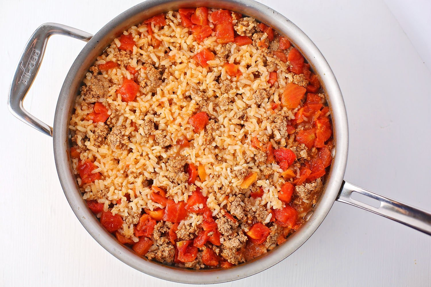 skillet with rice and tomato sauce