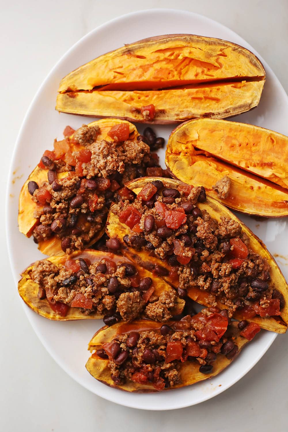 dish with sweet potatoes and meat sauce