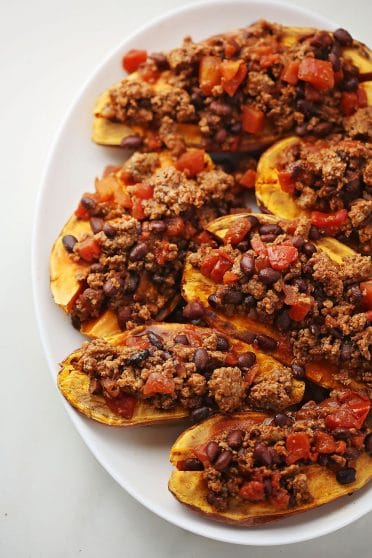 oval plate with Baked Potatoes with toppings