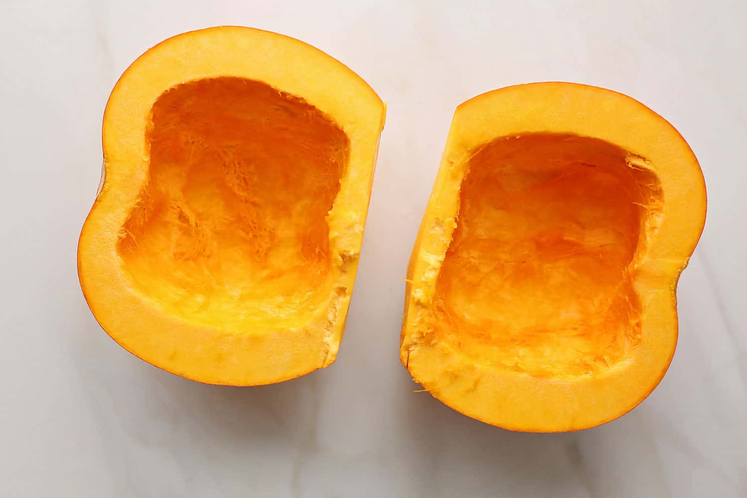 two pumpkin halves without seeds inside