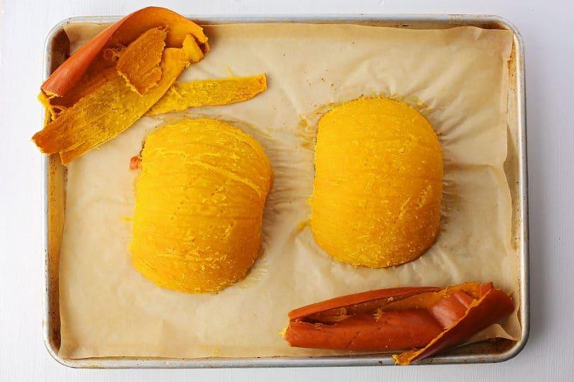 sheet pan with peeled baked pumpkin halves