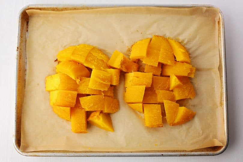 sheet pan with freshly baked pumpkin diced in large chunks