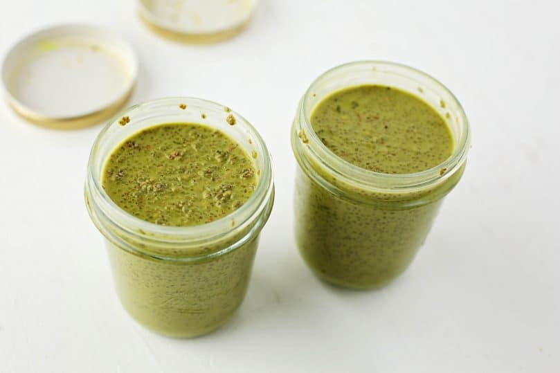 two glass jars with green tea pudding