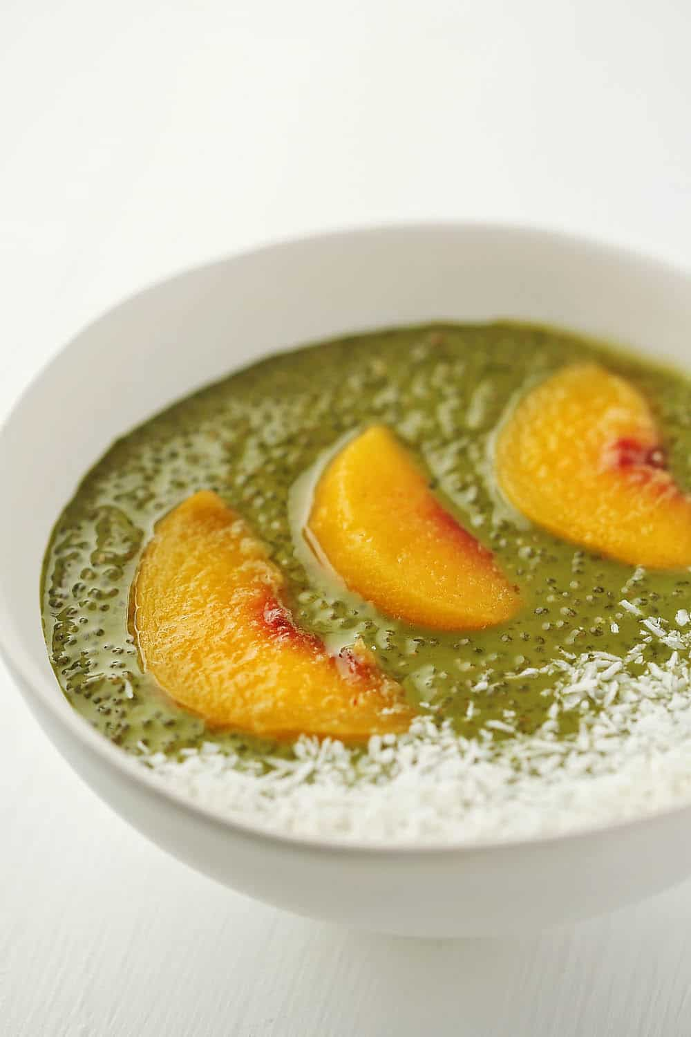 bowl with matcha pudding and peaches