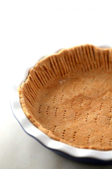 raw pie crust in the pie dish